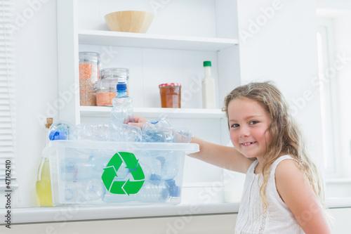 Girl sorting plastics into crates