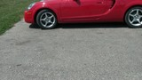 Red Sports Car Backing Up