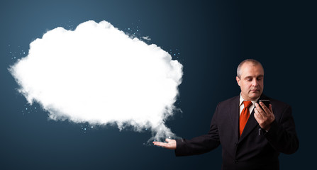 Businessman making phone call and presenting abstract cloud copy