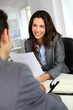 Businesswoman giving job interview - 47145426