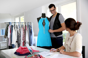Fashion designers working on creation in workshop