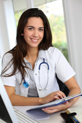 Portrait of smiling young woman doctor