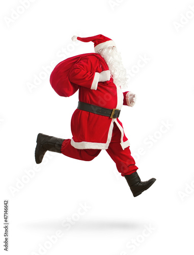 Leinwanddruck Bild Santa Claus on the run to delivery christmas presents