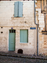 Front door and closed shutters in France