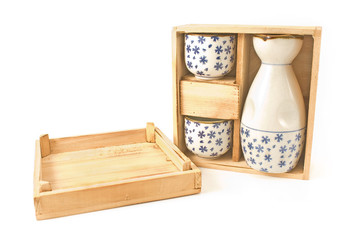 Antique porcelain vase and cups in wooden box