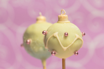 Christmas cake pops on pink background