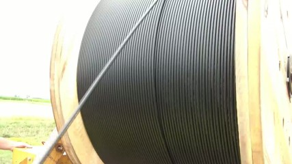 Unreeling Fiber Optic Cable into Hole