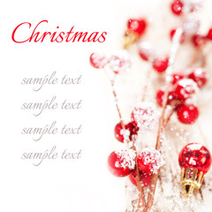 Christmas decorative background with berries and balls