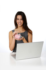 Smiling girl inserting coing in piggy bank
