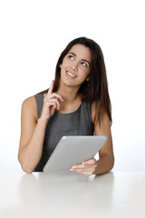 Woman using tablet and pointing at message board
