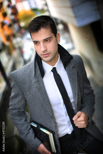 Trendy active man walking in town