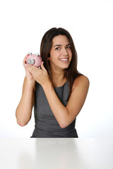 Portrait of beautiful woman holding piggy bank