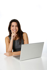 Cheerful young woman in front of laptop
