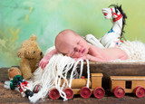 Old toys and newborn baby