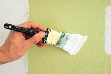 Painting a Wall White with Paint Brush