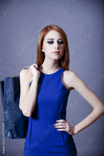 Women in blue dress with bag