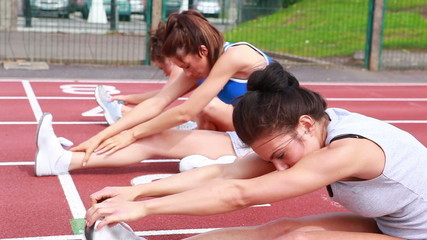 Women stretching on a track