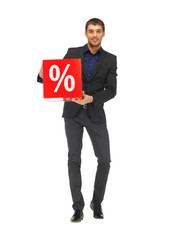 handsome man in suit with percent sign