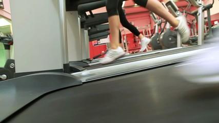 Three people running on treadmills