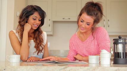 Women sitting in the kitchen