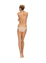 rear view of beautiful topless woman in panties