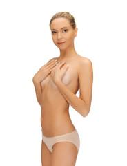 beautiful topless woman in panties
