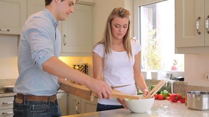 Couple preparing salad
