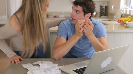 Couple stressing over bills