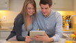 Couple looking at a tablet PC