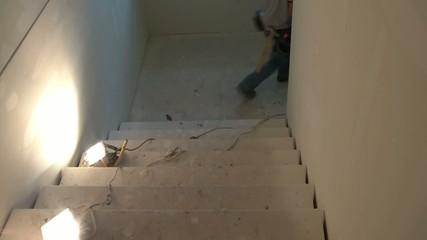 Construction Worker Walking Downstairs
