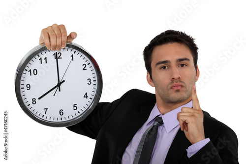 Stern businessman with a clock
