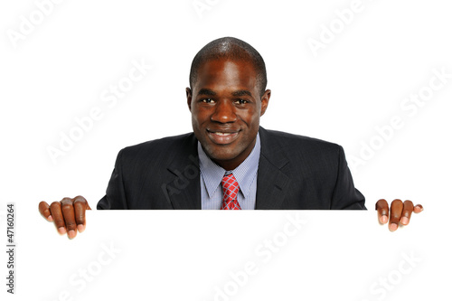 Young African American Businessman Holdin a blank sign