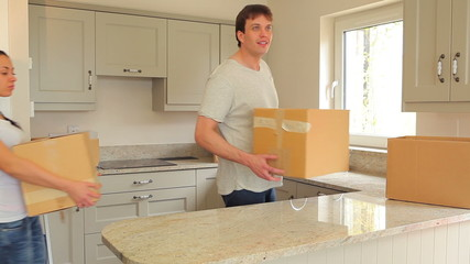 Couple proudly put moving boxes in the kitchen