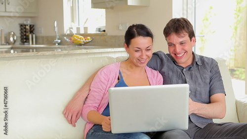 Couple on video chat on laptop