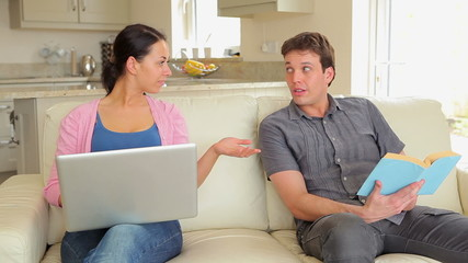 Man giving wife credit card for online shopping