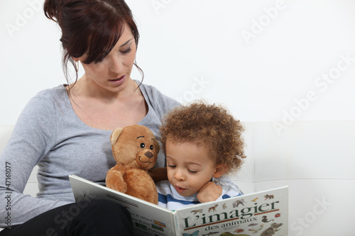 Mother reading story to son