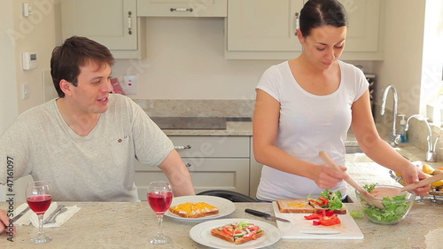 Woman preparing sandwches for lunch with husband