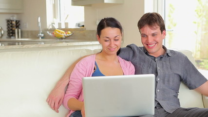 Couple watching movie on laptop