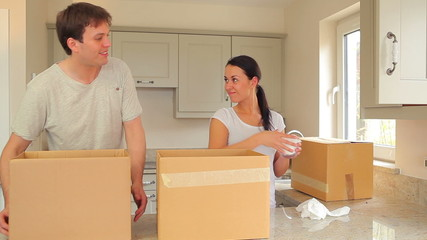 Couple unpacking after move