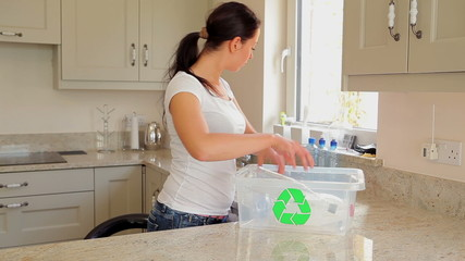 Woman recycling plastic bottles