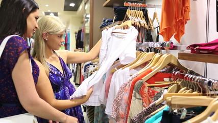 Women looking through clothes rail