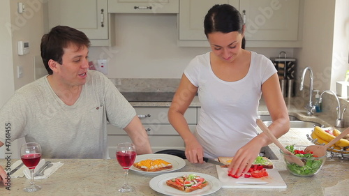 Woman preparing salad and sandwiches