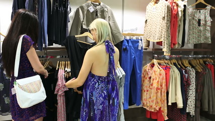 Women friends looking through clothes