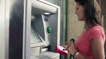 Woman withdraw cash from ATM machine, steadicam shot