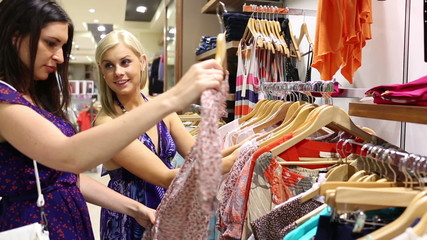 Women looking at shirts