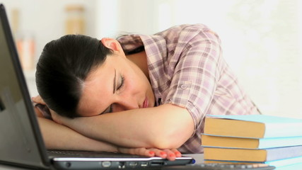 Woman napping in front of laptop