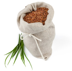 Sack of red rice with greens