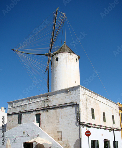 Windmill on the roof of an old house