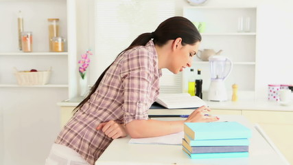 Woman studying and smiling