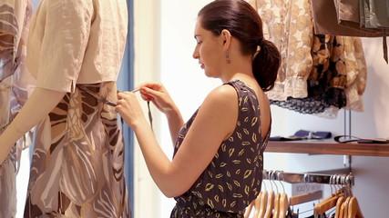Woman dressing mannequin